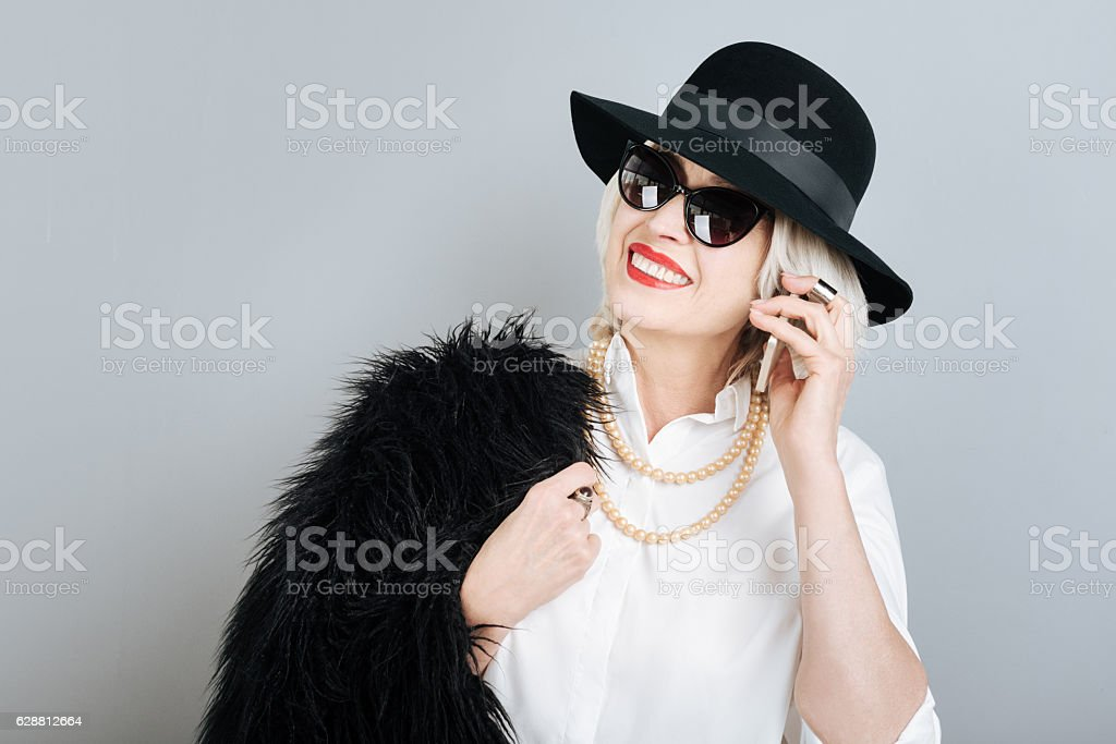 Beautiful smiling woman talking on cellphone. stock photo