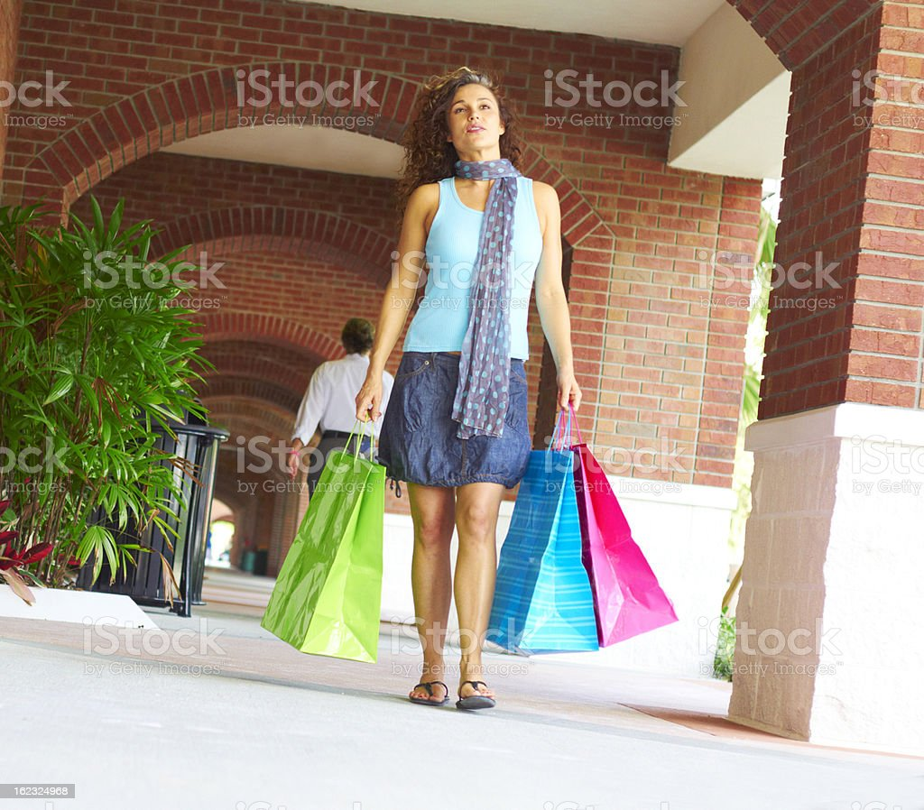 Beautiful Smiling Woman Walking With Shopping Bags royalty-free stock photo