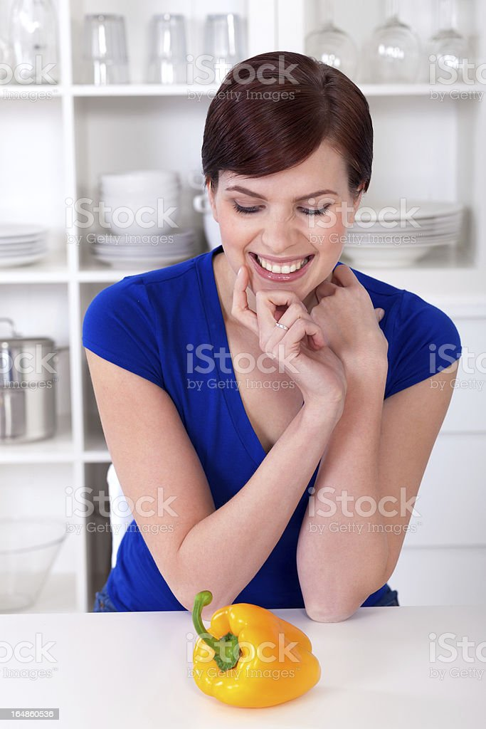 beautiful smiling woman with a yellow sweet pepper royalty-free stock photo