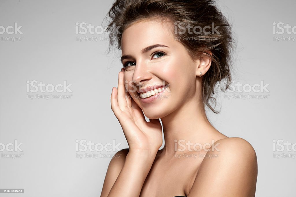 Beautiful smiling woman with clean skin, natural make-up stock photo