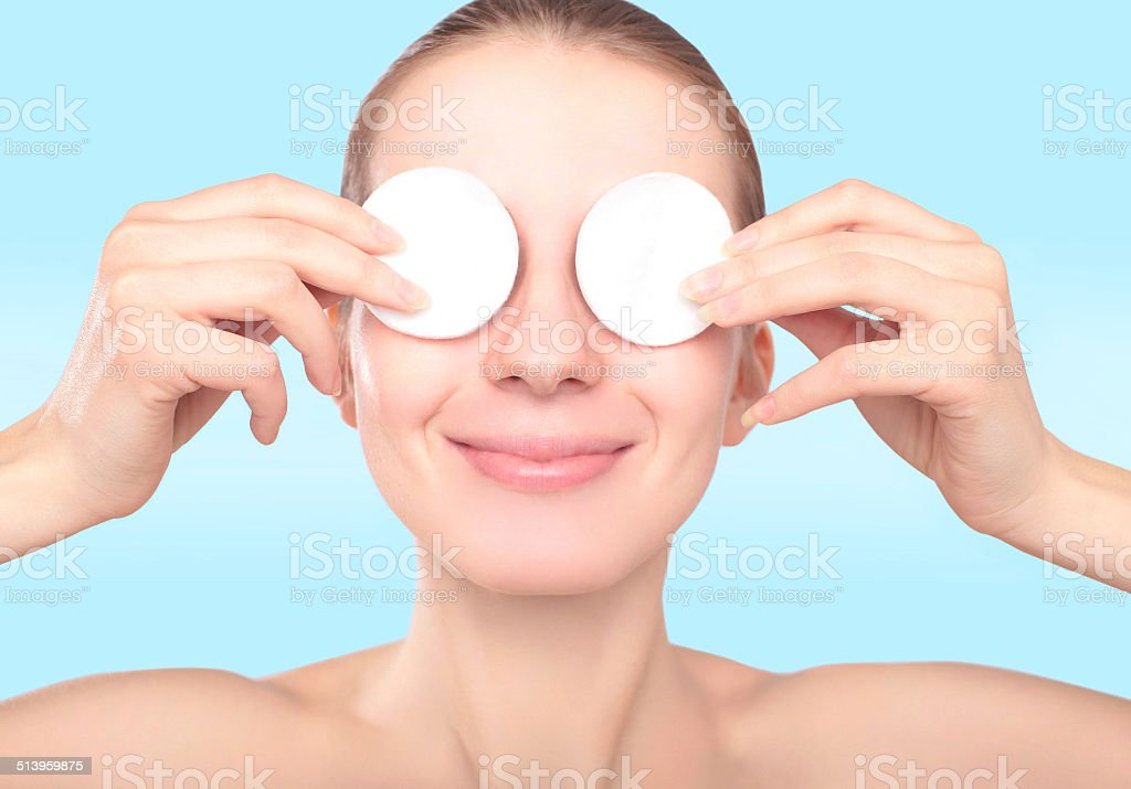 Beautiful smiling woman with cotton pads stock photo
