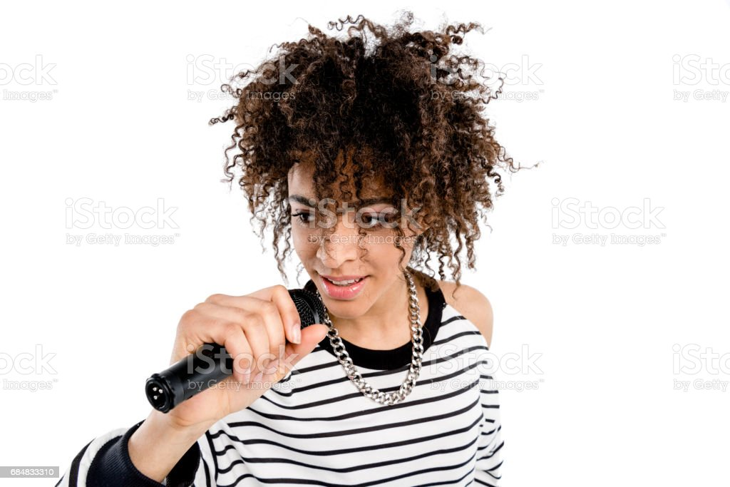 Beautiful smiling woman with microphone singing isolated on white, heavy metal singer concept stock photo