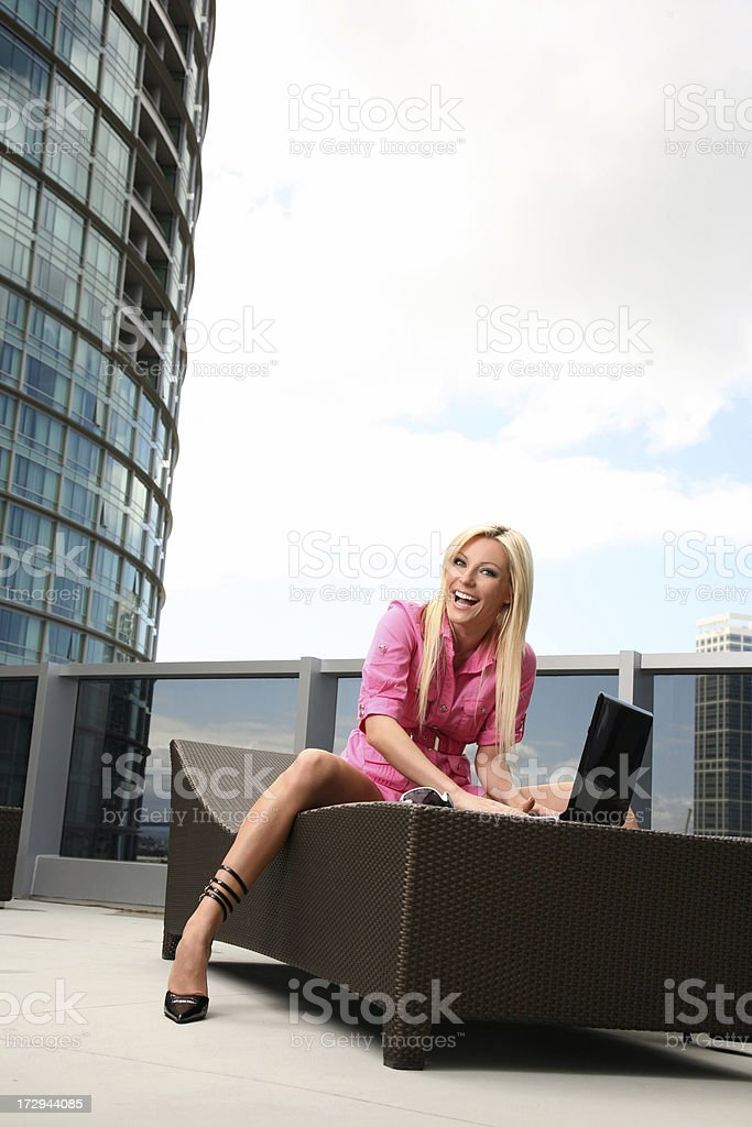 Beautiful smiling  woman working on Laptop Computer downtown royalty-free stock photo