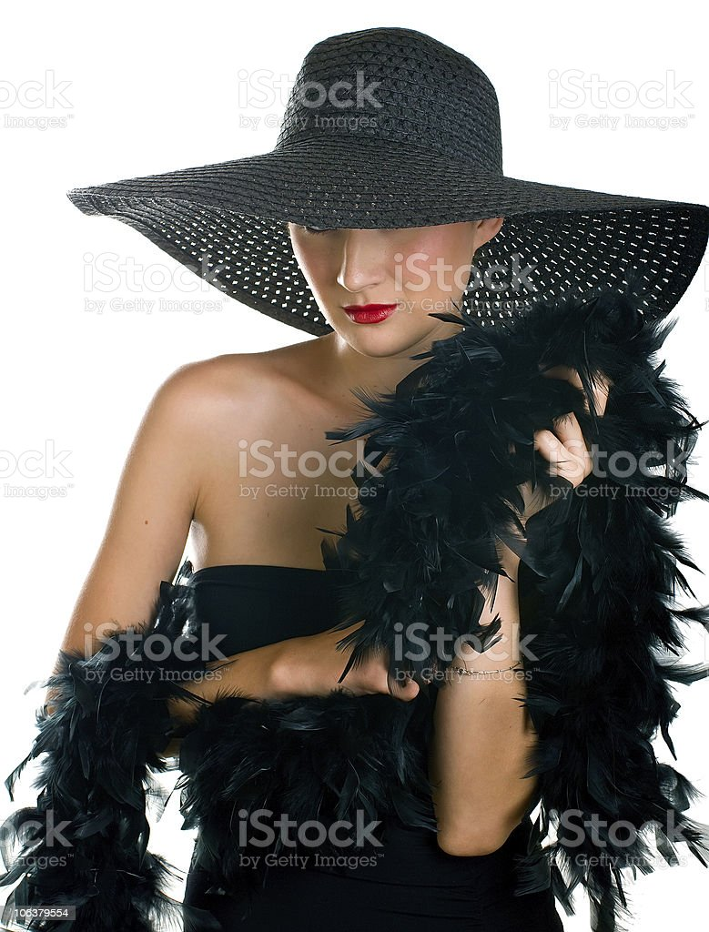 beautiful smiling women in black hat and boa royalty-free stock photo