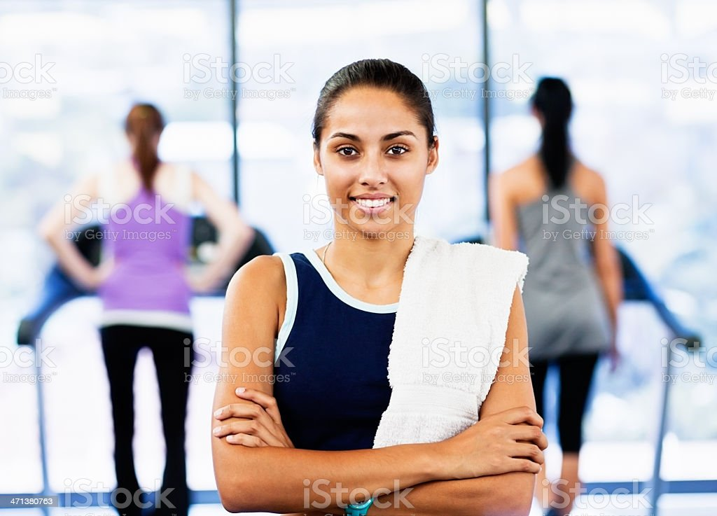 Beautiful smiling young woman relaxing after gym stock photo