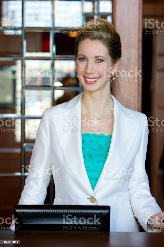 Beautiful, Smiling Young Woman Restaurant Hostess, Copy Space stock photo