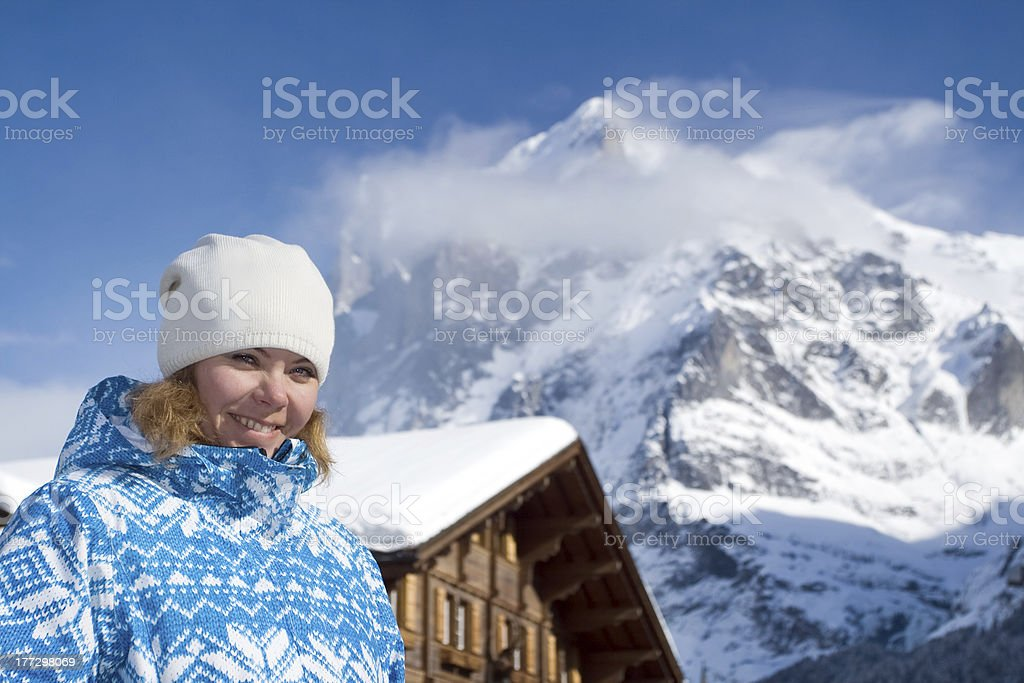 Beautiful smiling young woman. Swiss alps at winter royalty-free stock photo
