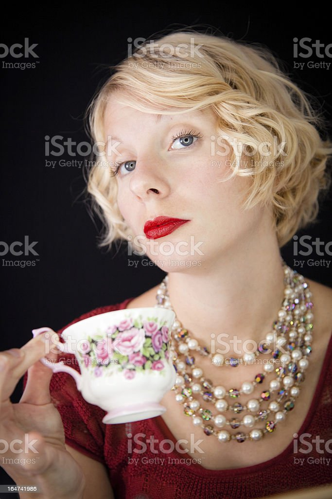 Beautiful Snobbish lady holding a cup of tea royalty-free stock photo