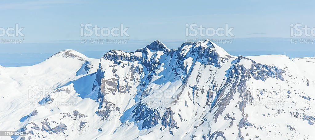 Beautiful snow-capped mountains against the blue sky royalty-free stock photo
