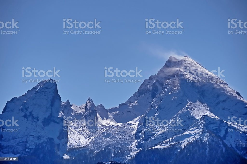 Beautiful snowcapped twin peak mountain against clear blue sky stock photo