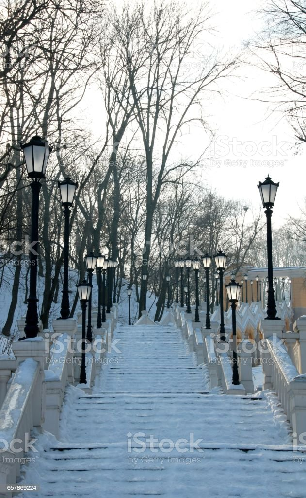 beautiful snowy stairs in the city Park in winter stock photo