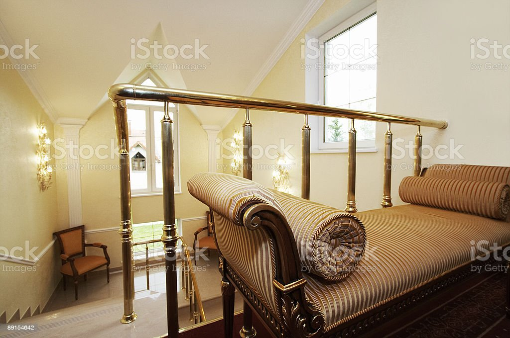 Beautiful sofa and staircase royalty-free stock photo
