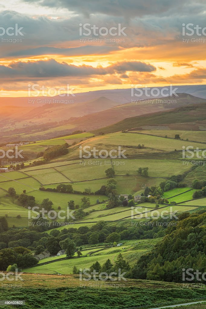 Beautiful Soft Orange Rays Of Light In The Peak District. stock photo