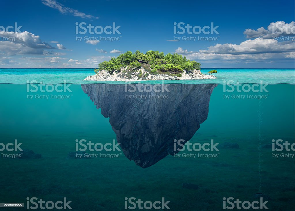 Beautiful solitude island with green trees in the ocean stock photo