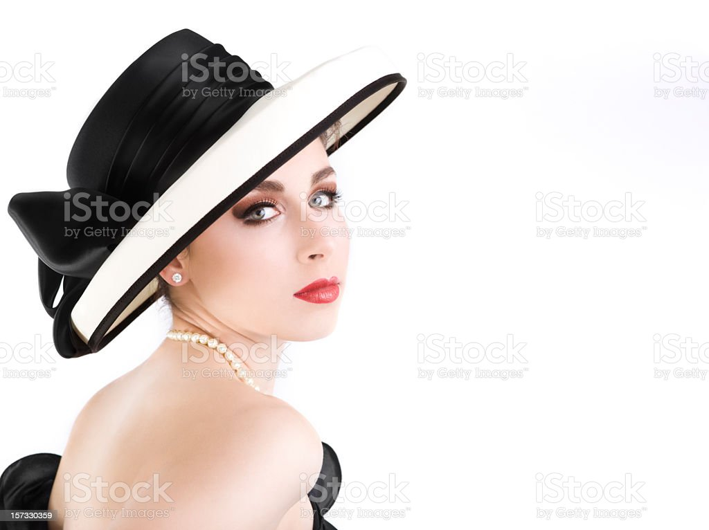 Beautiful Sophisticated Chanel Girl with Uncropped Hat on White, Copyspace royalty-free stock photo