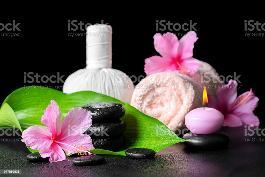beautiful spa background of pink hibiscus flowers, leaf, candle, stock photo