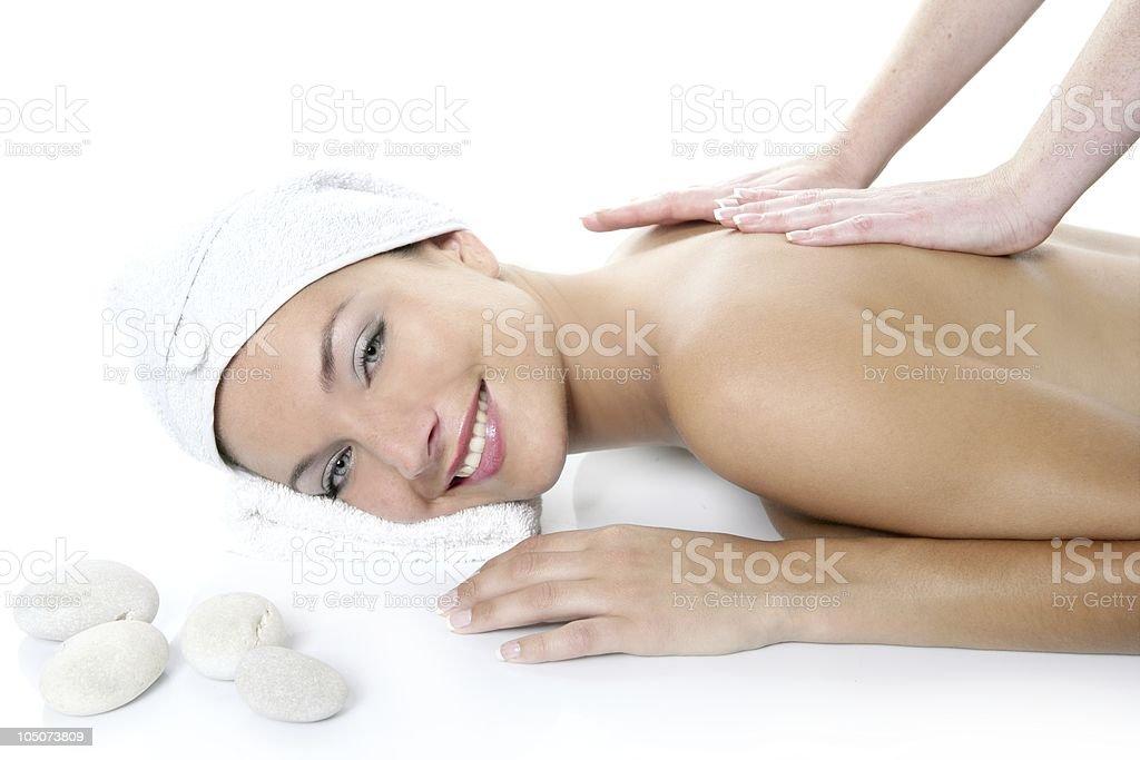 Beautiful spa blue eyes woman having massage stock photo