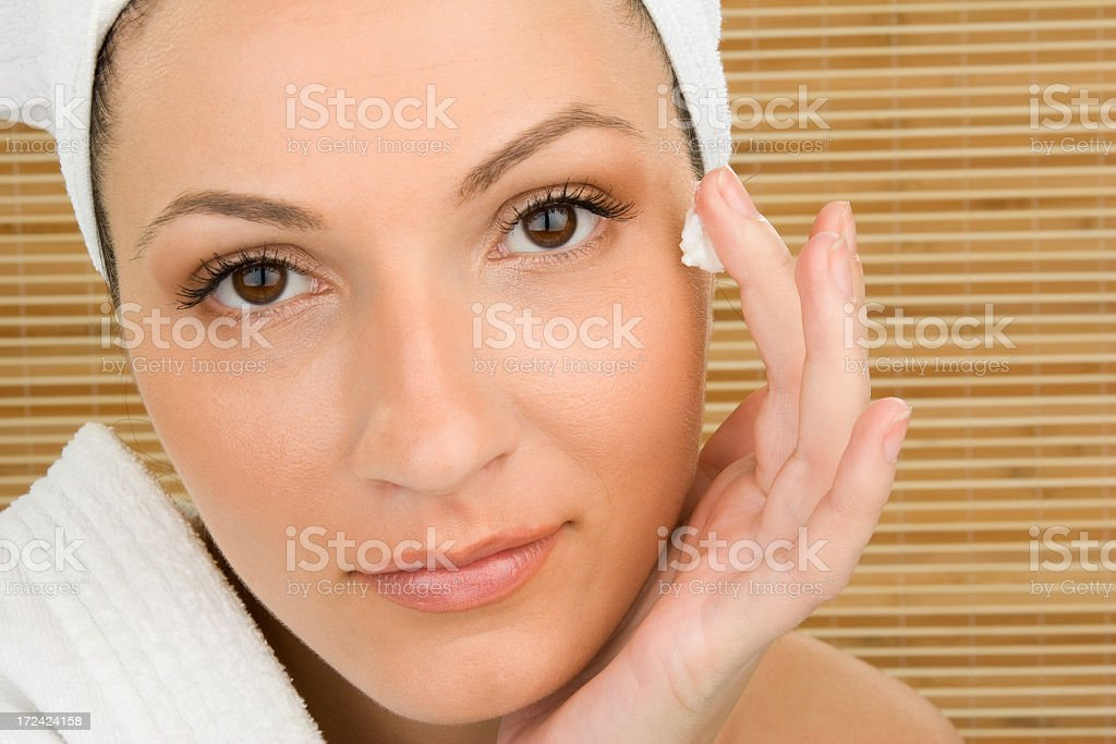 Beautiful spa girl with creme royalty-free stock photo