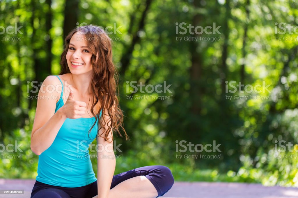 Beautiful and athletic girl with sport clothes looking at the camera...