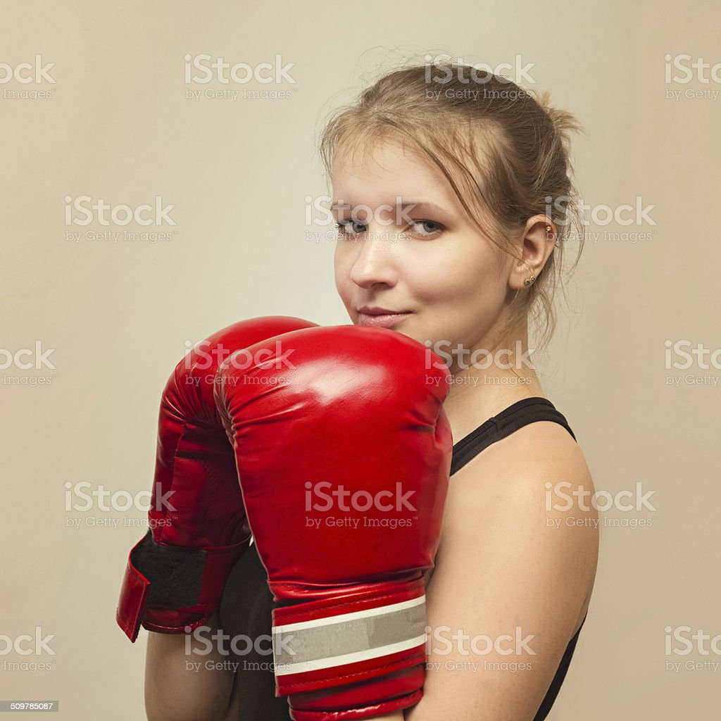beautiful sports girl with boxing gloves stock photo
