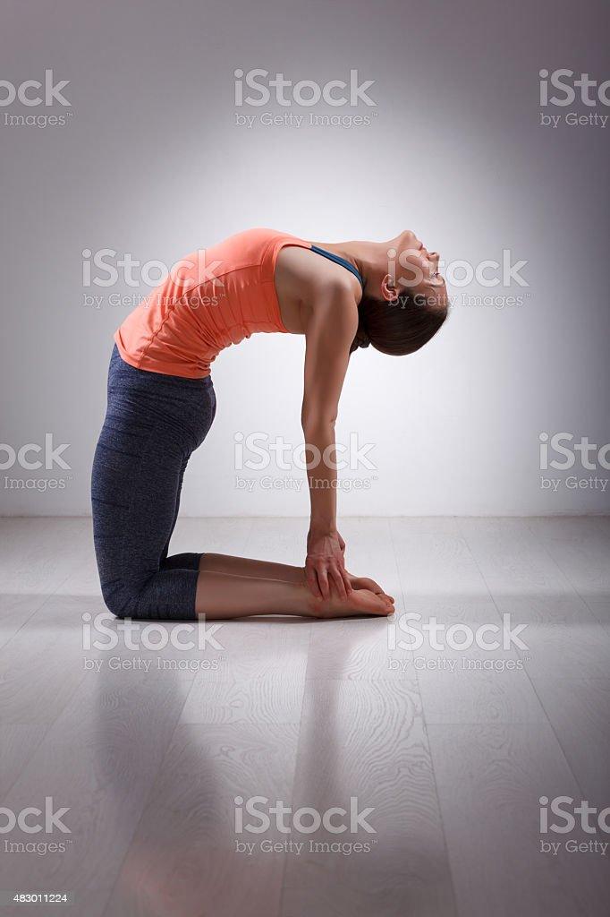 Beautiful sporty fit yogini woman practices yoga asana ustrasana stock photo
