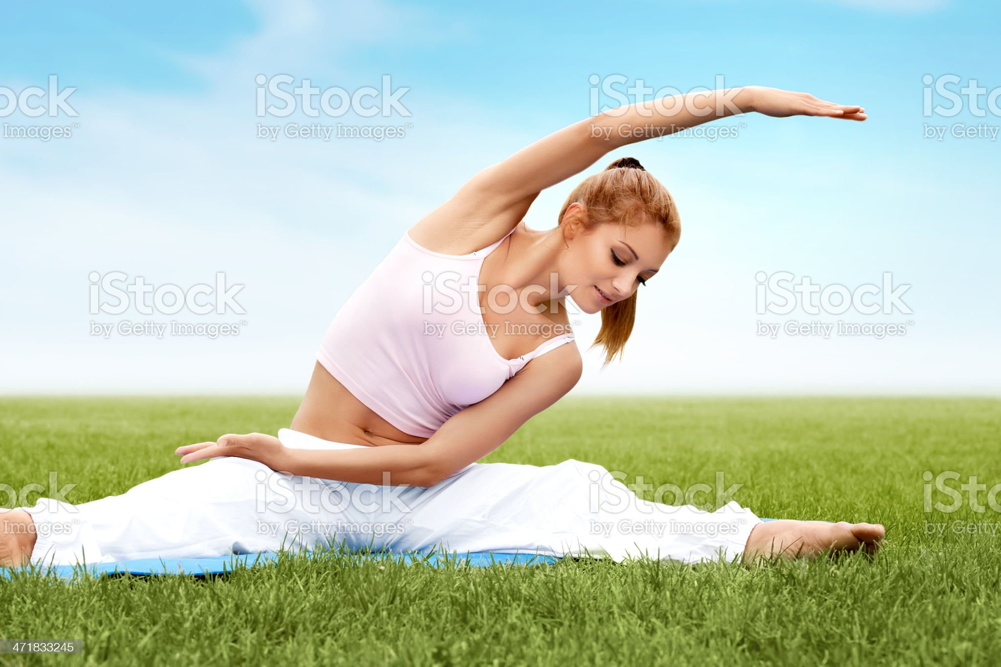 Beautiful sporty woman doing stretching exercise royalty-free stock photo
