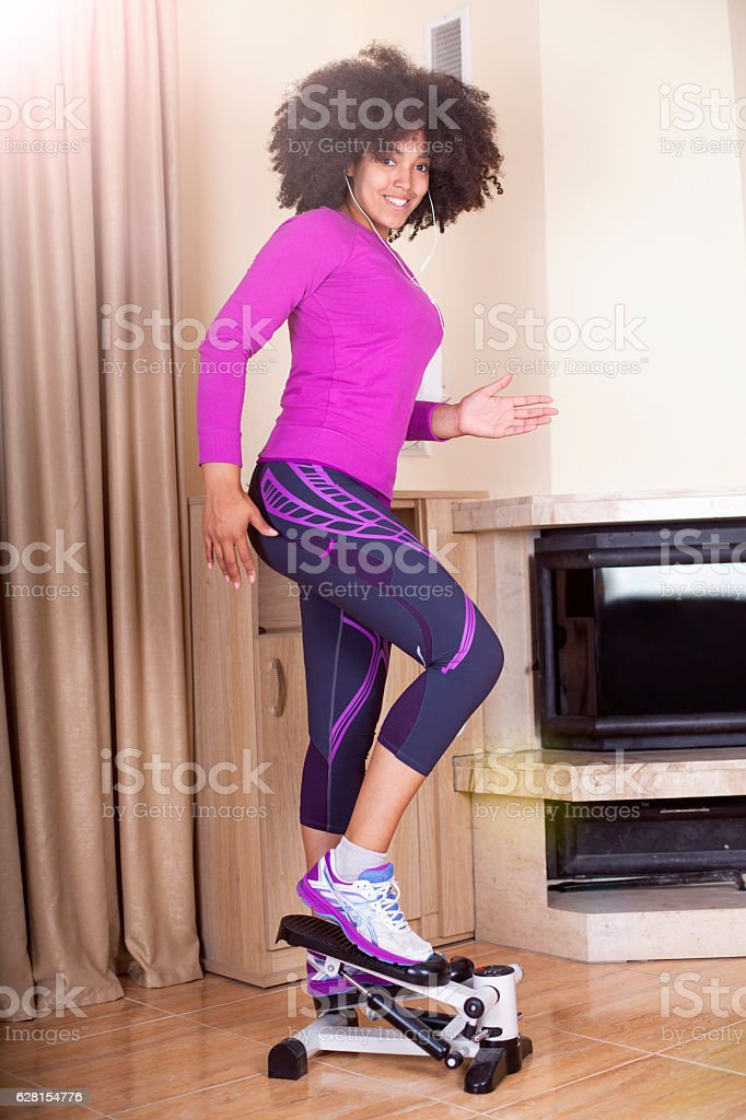 Beautiful sporty young woman doing exercise in gym. stock photo