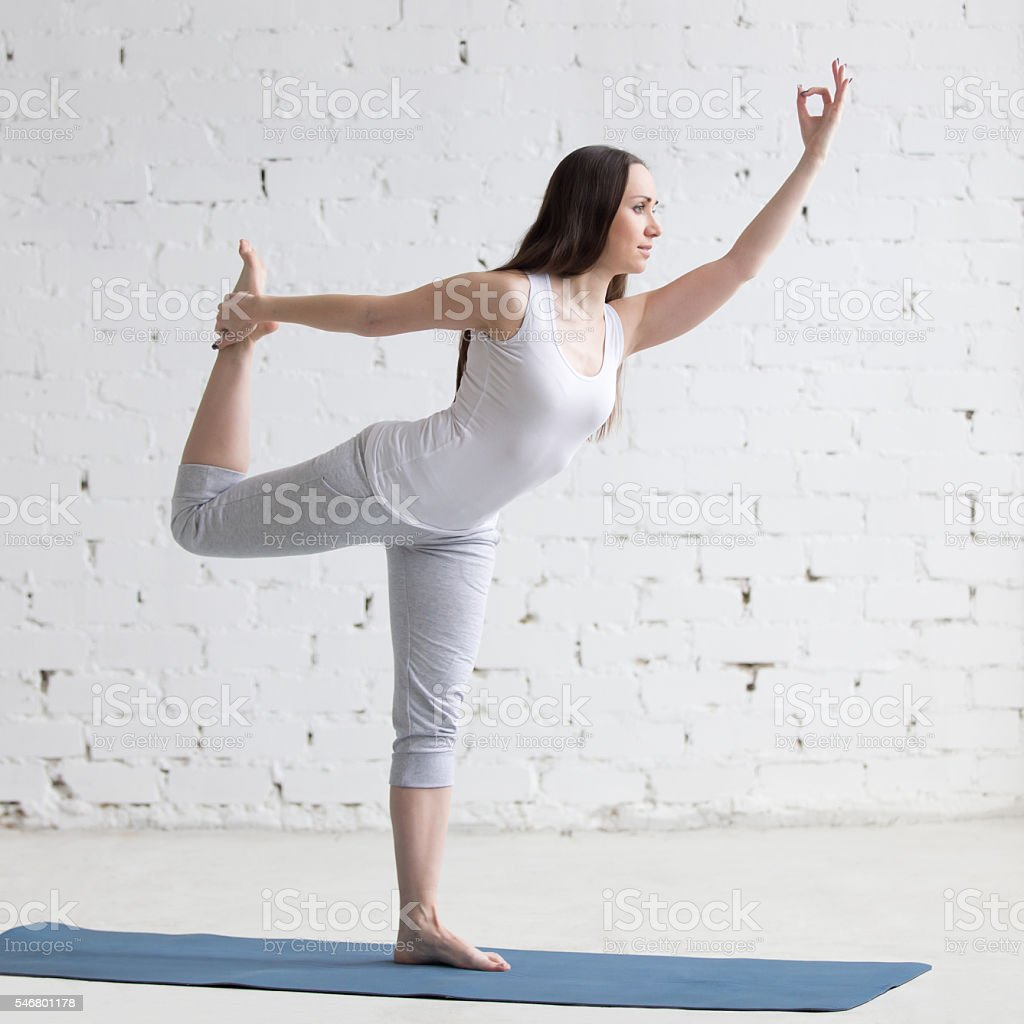 Beautiful sporty young woman doing yoga stock photo