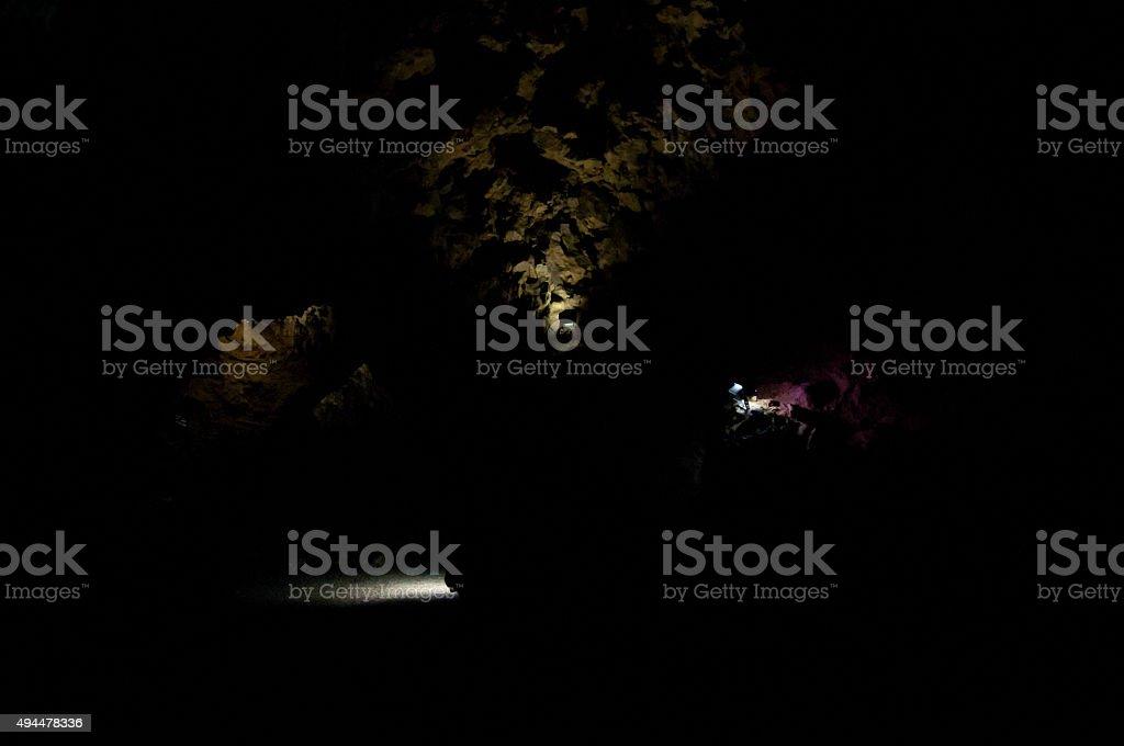 beautiful spotlights in black cavern stock photo