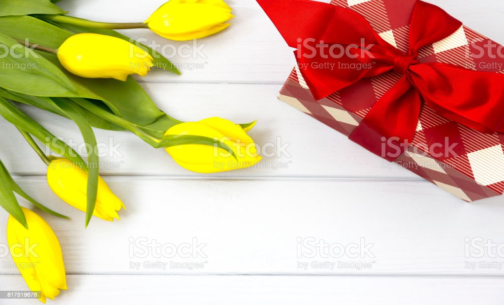 Beautiful spring Flat Lay with yellow Tulips and Gift box stock photo
