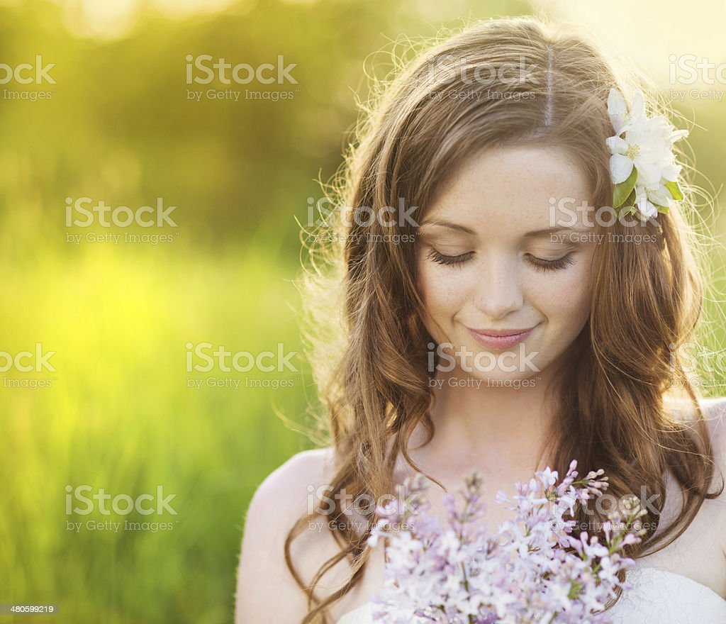 Beautiful spring girl with flowers on the meadow stock photo