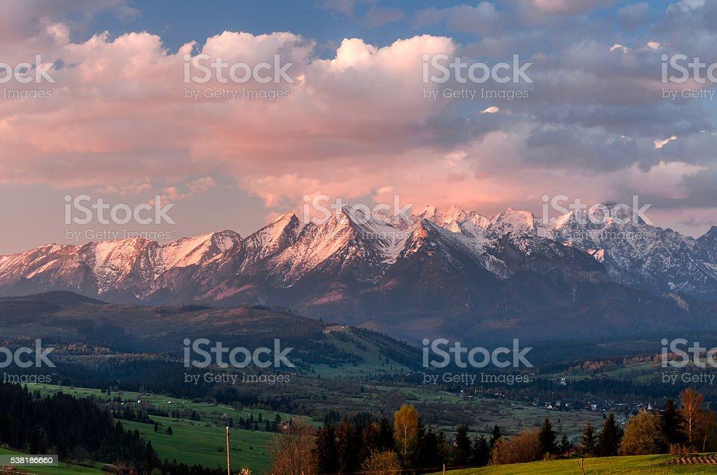 Beautiful spring panorama of Tatra mountains and green hills stock photo