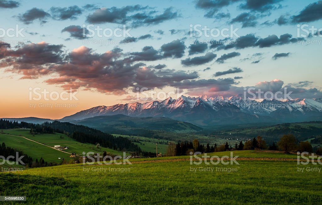 Beautiful spring panorama of Tatra mountains and green hills stock photo
