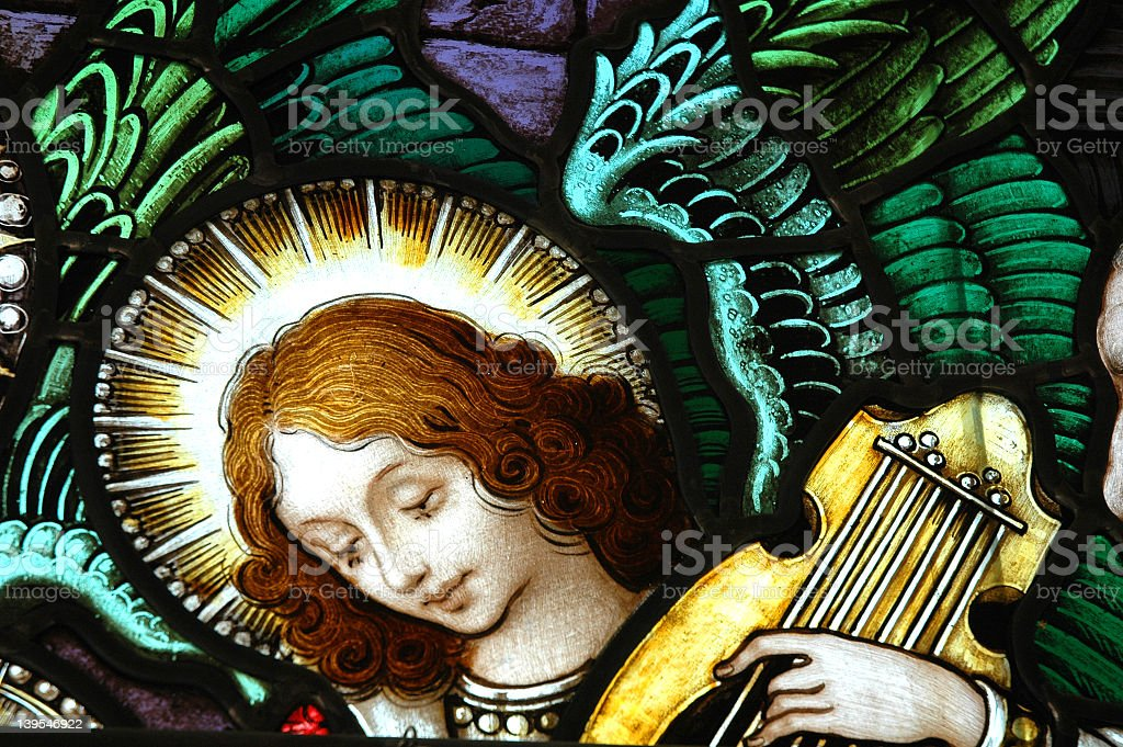 Beautiful stained glass window with a angel stock photo