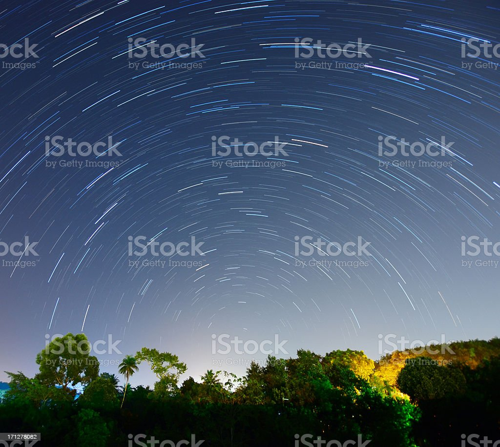 Beautiful Star Trails above tropical forest in a country rural royalty-free stock photo