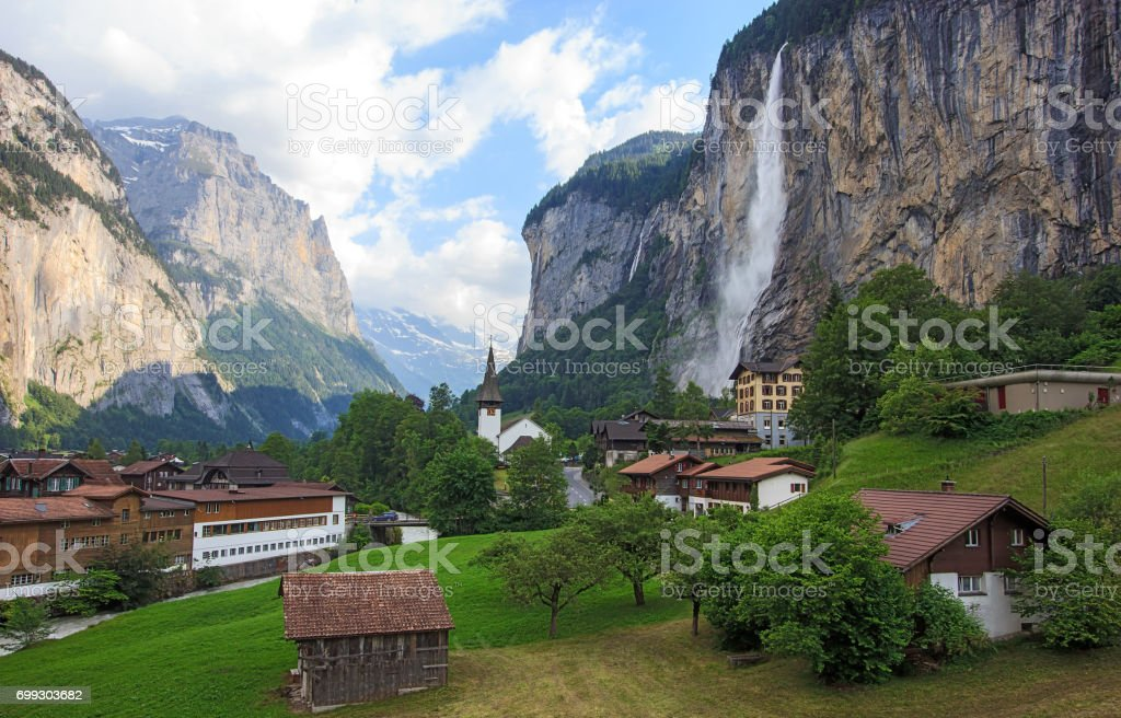Beautiful Staubbachfall waterfall flowing down the picturesque Lauterbrunnen valley and village in Bern canton, Switzerland, Europe stock photo