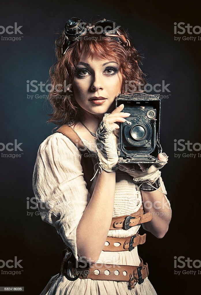 Beautiful steampunk girl with old camera stock photo