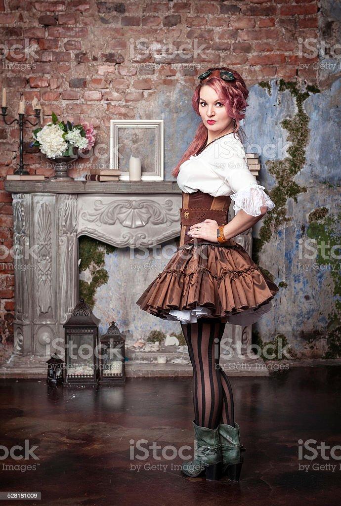 Beautiful steampunk woman posing stock photo