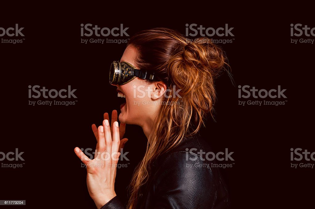 Beautiful steampunk woman profile portrait laughing stock photo