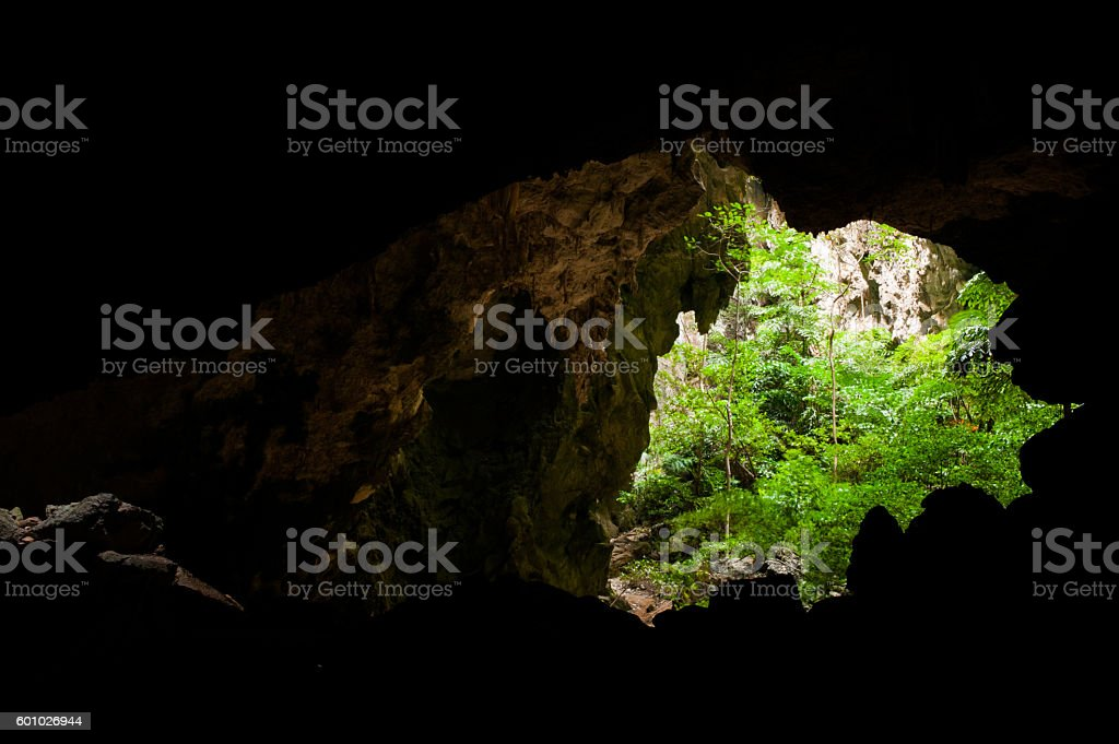 Beautiful stone Cave with above light. stock photo
