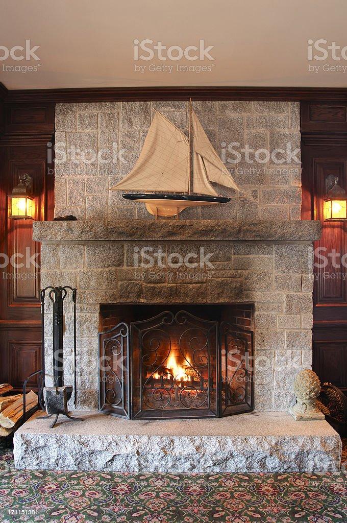 Beautiful stone wood burning fireplace stock photo