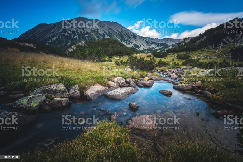Beautiful stream in a mountain valley stock photo
