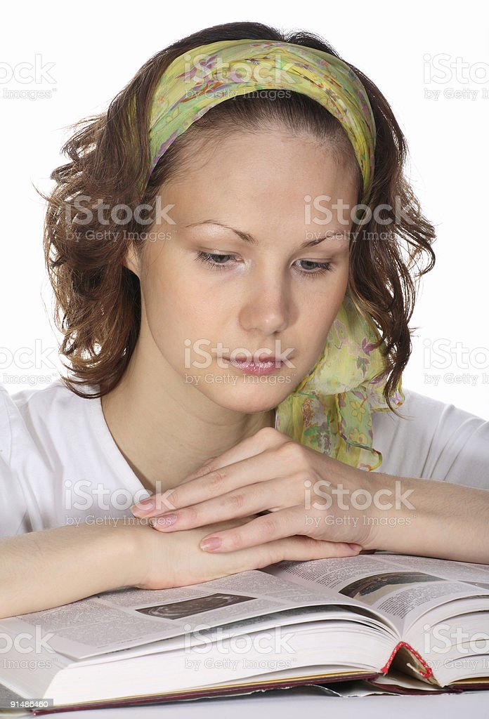 Beautiful student girl with green headscarf reading book royalty-free stock photo