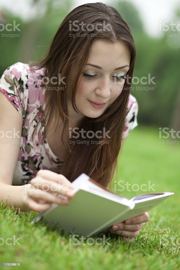 beautiful student with book in park royalty-free stock photo