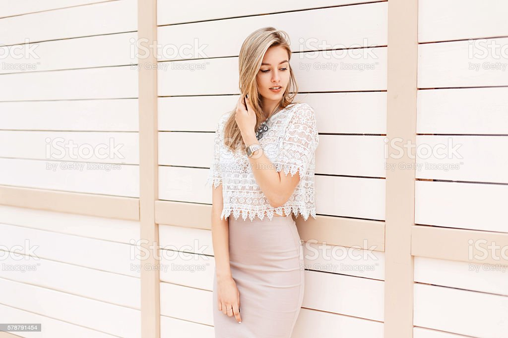 Beautiful stylish girl in vintage lace blouse with ornament posing stock photo