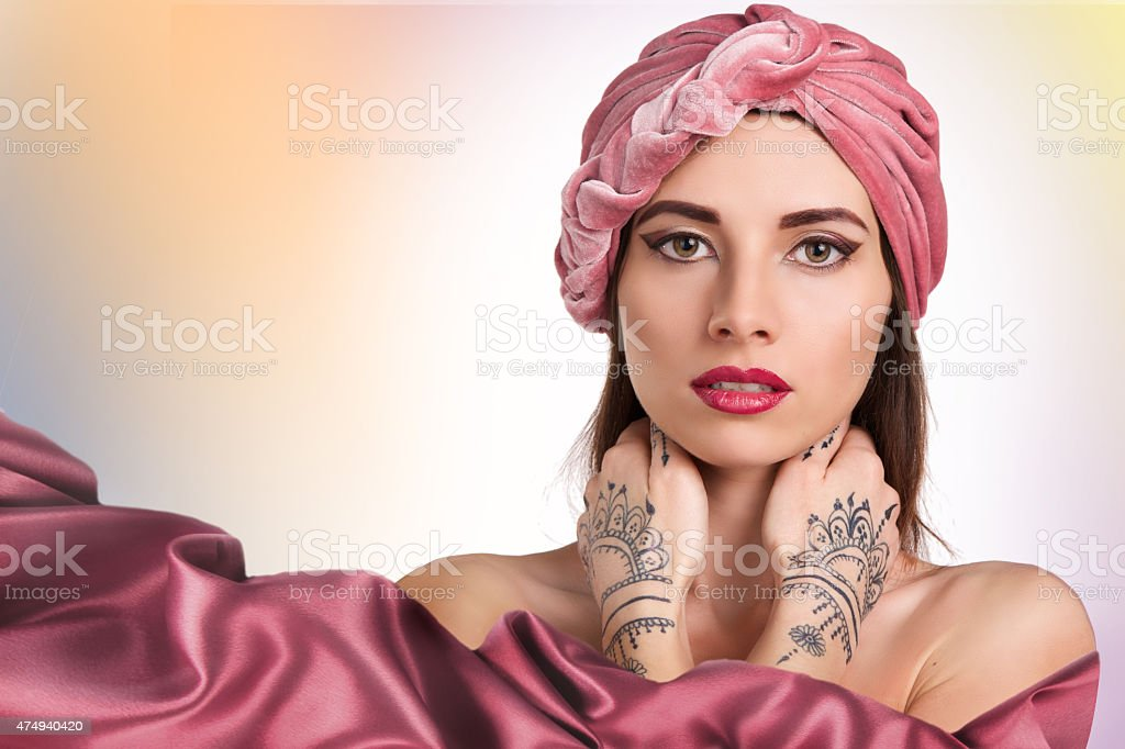 beautiful stylish woman in oriental style in turban stock photo