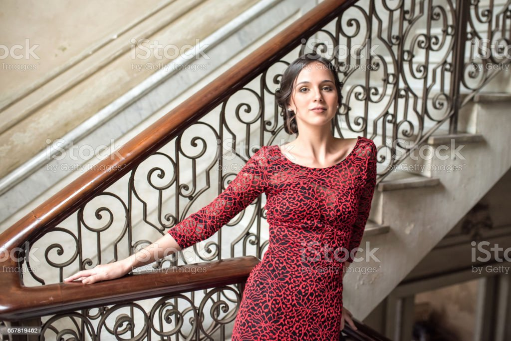 beautiful stylish young cuban woman leaning on balustrade in old house stock photo