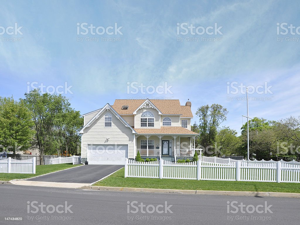 Beautiful Suburban Home White Picket Fence stock photo