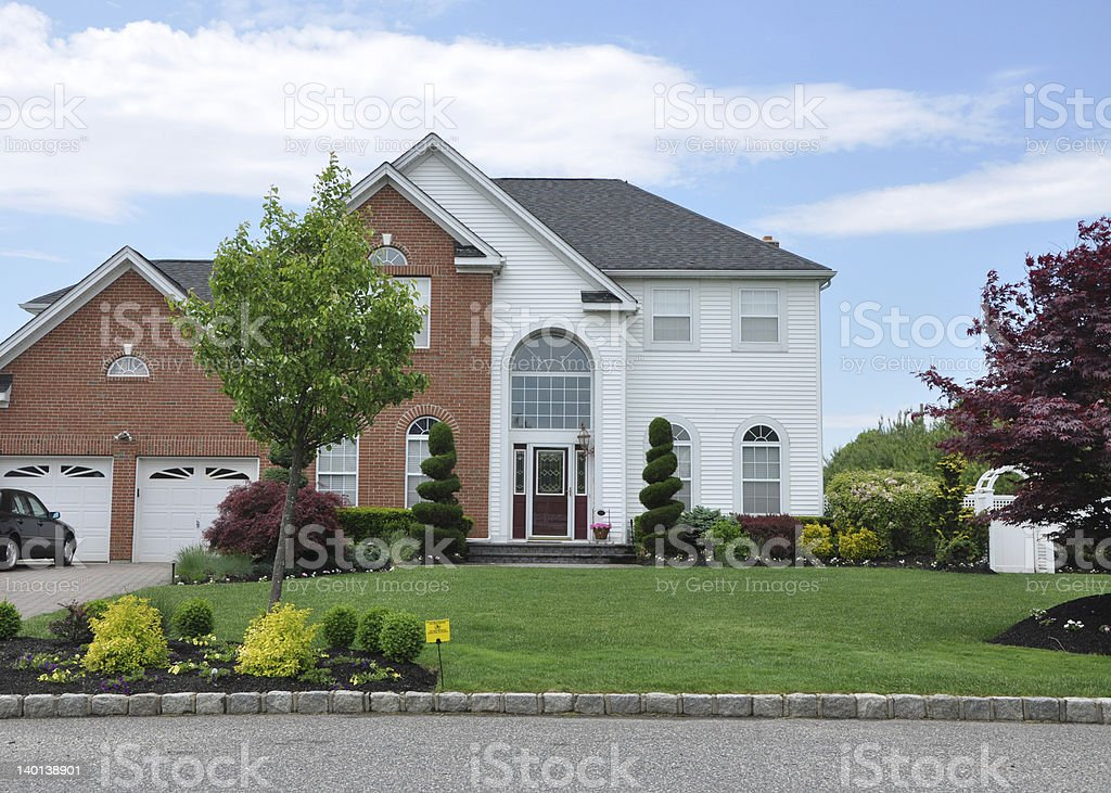 Beautiful Suburban Home with Pesticide Sign stock photo