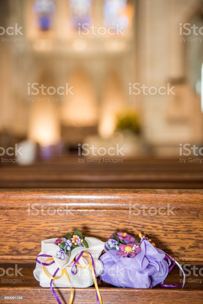 Beautiful sugar package wedding decoration in a church during catholic wedding ceremony stock photo